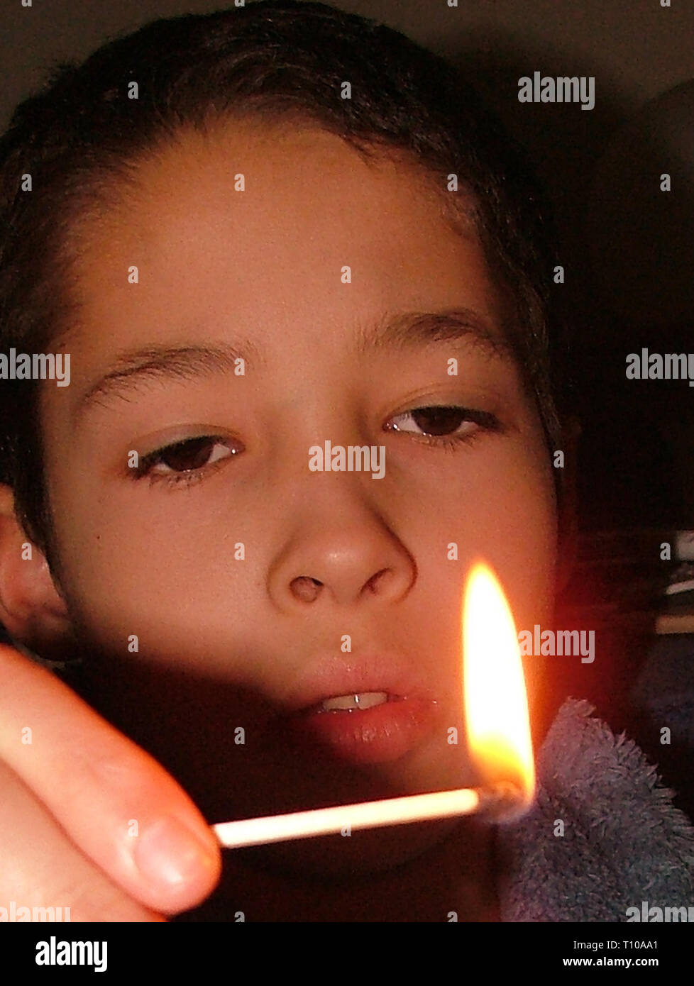 Arson, children Playing with fire - Stock Image