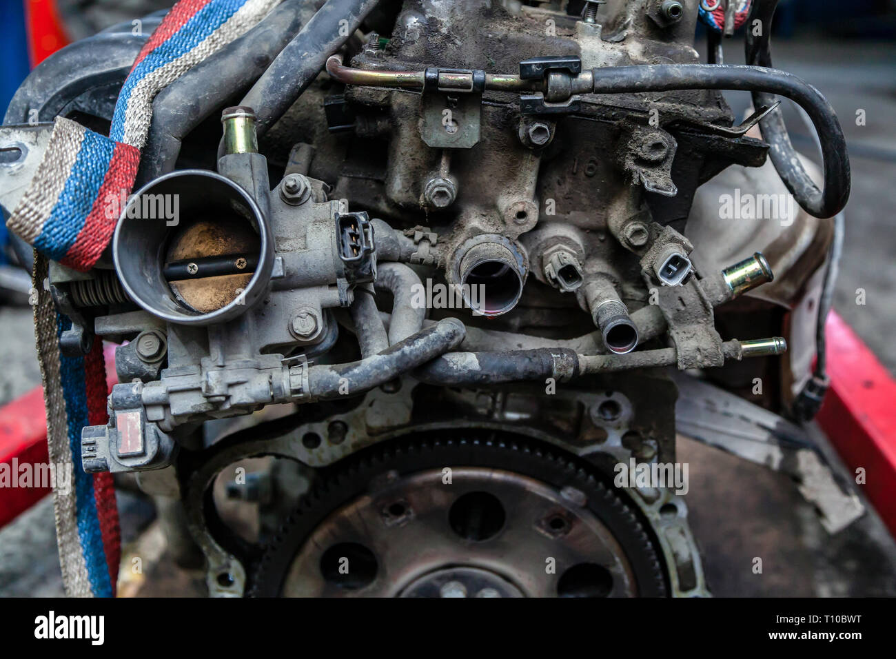 Close-up of the engine, throttle, raditor. Engine breakdown: contaminated throttle of an old car Stock Photo