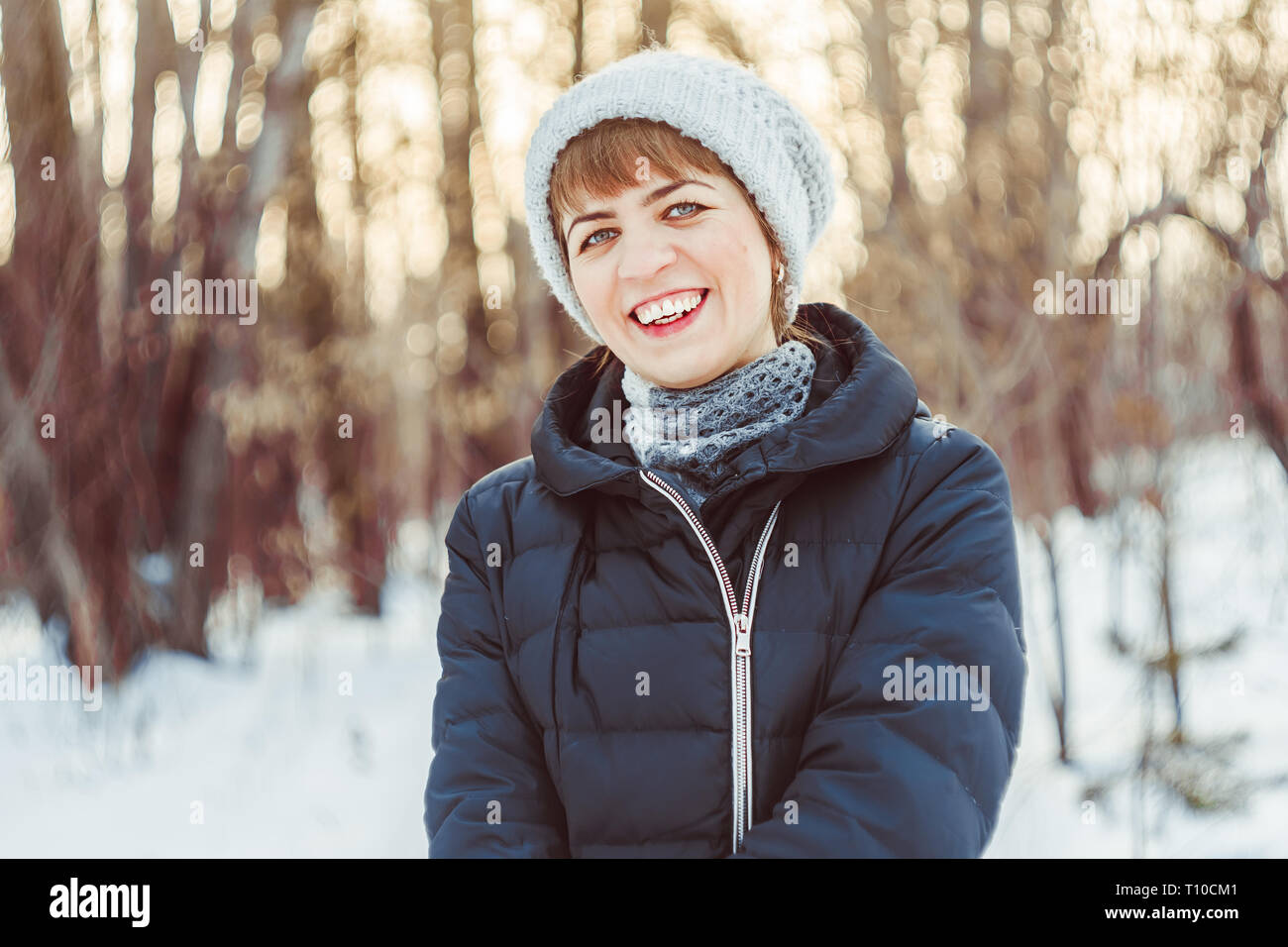 d1817a64c50d8 Close-up portrait of a cheerful girl in warm clothes with a backpack,  standing