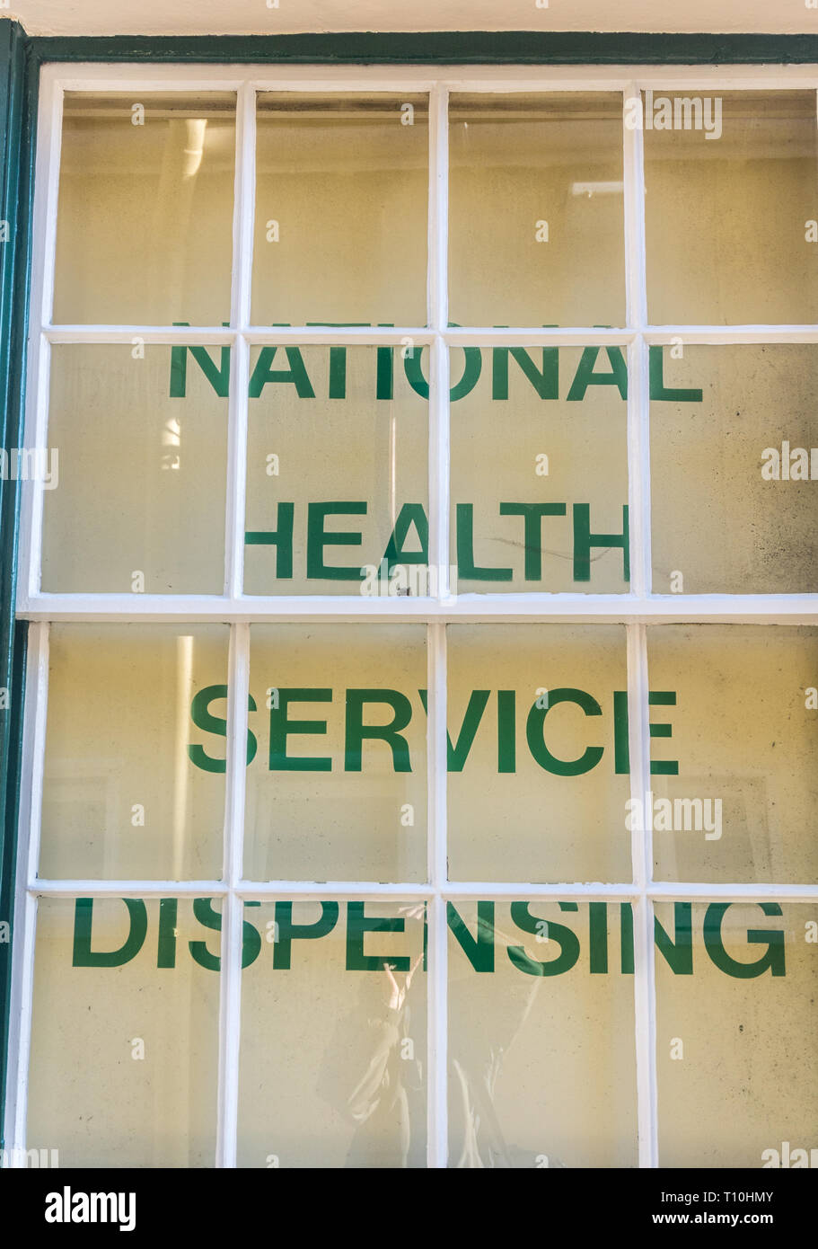 NHS sign in small chemist's window - Stock Image