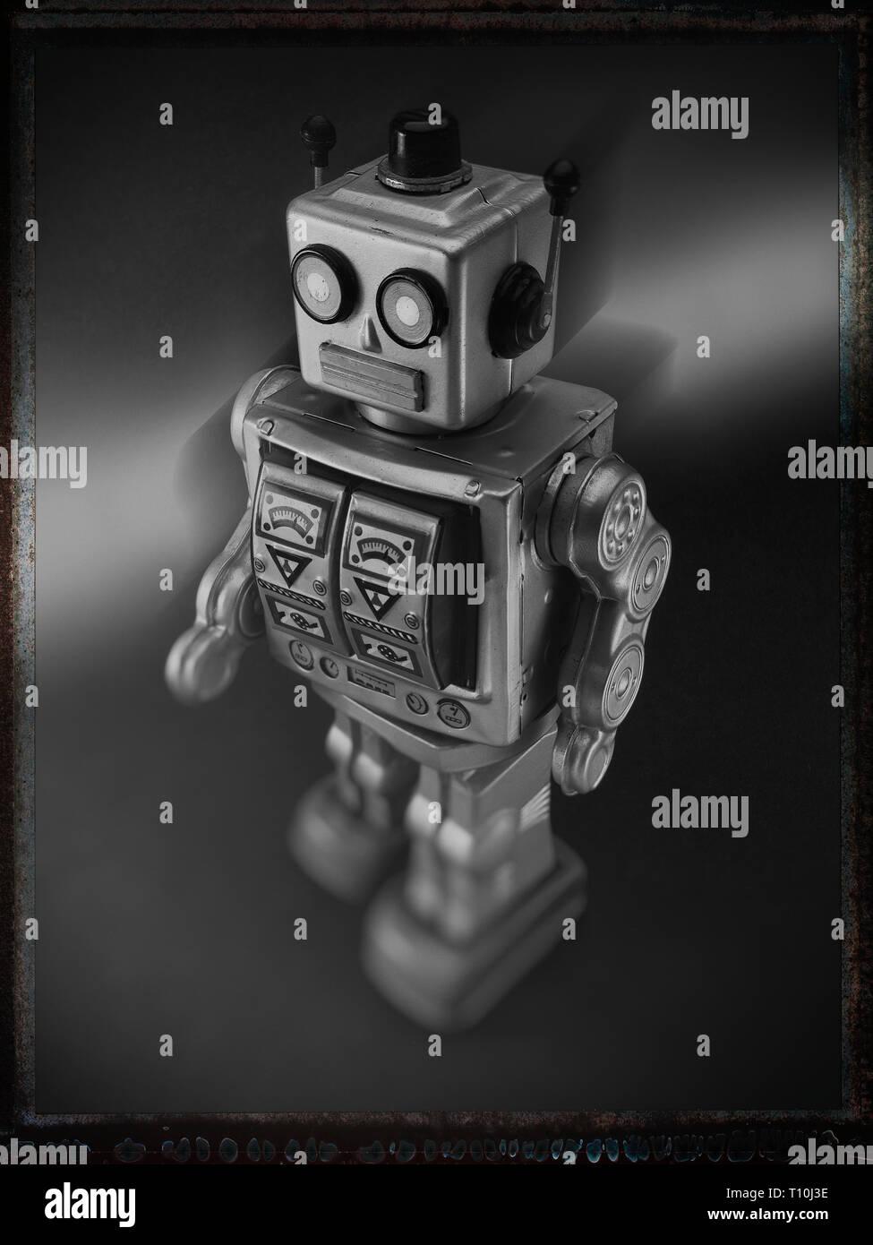 black and white image of toy tin robot Stock Photo