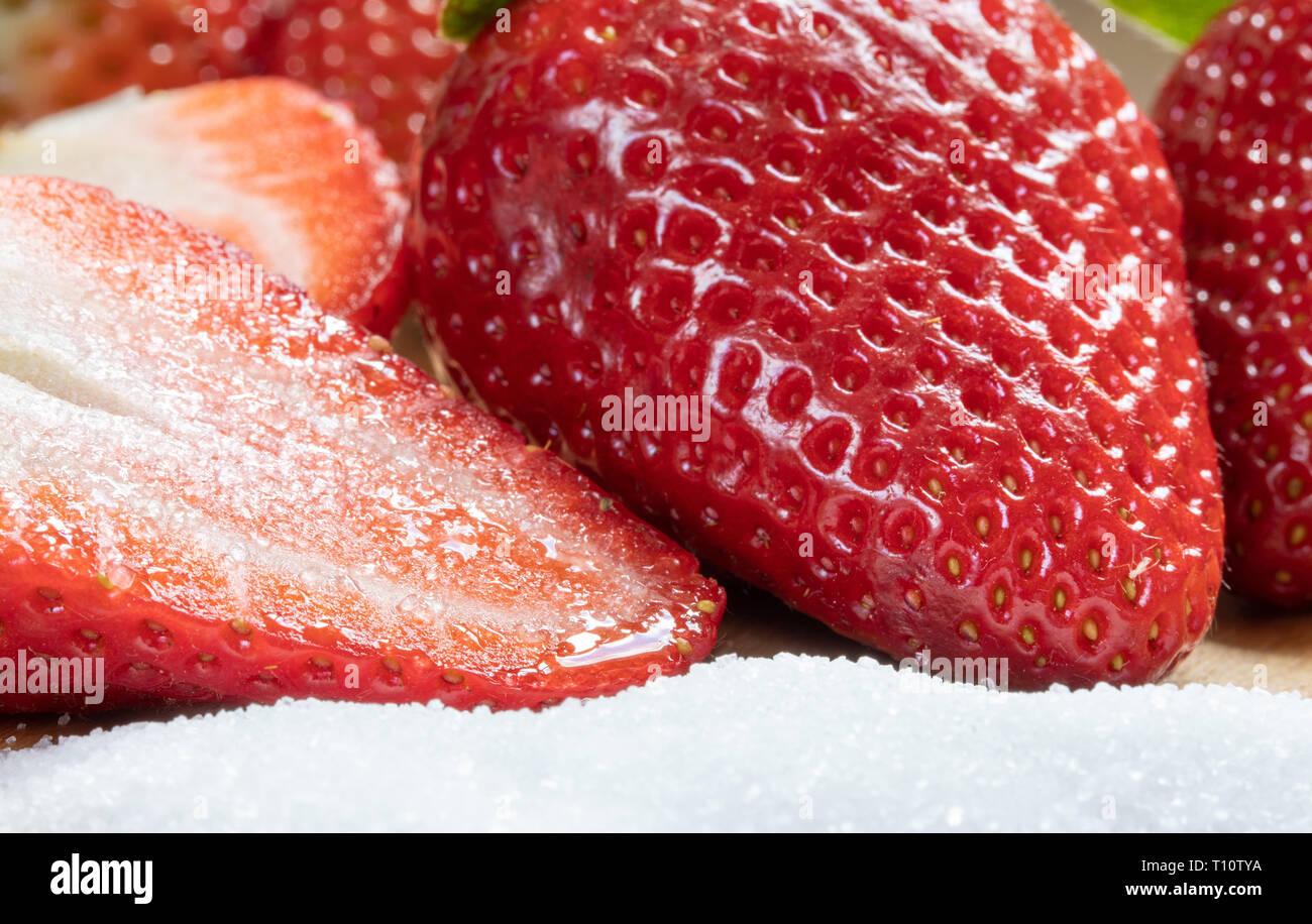 Sweetness Half Strawberry On The Sugar. Sweet Dessert. Food And Macro Photography - Stock Image