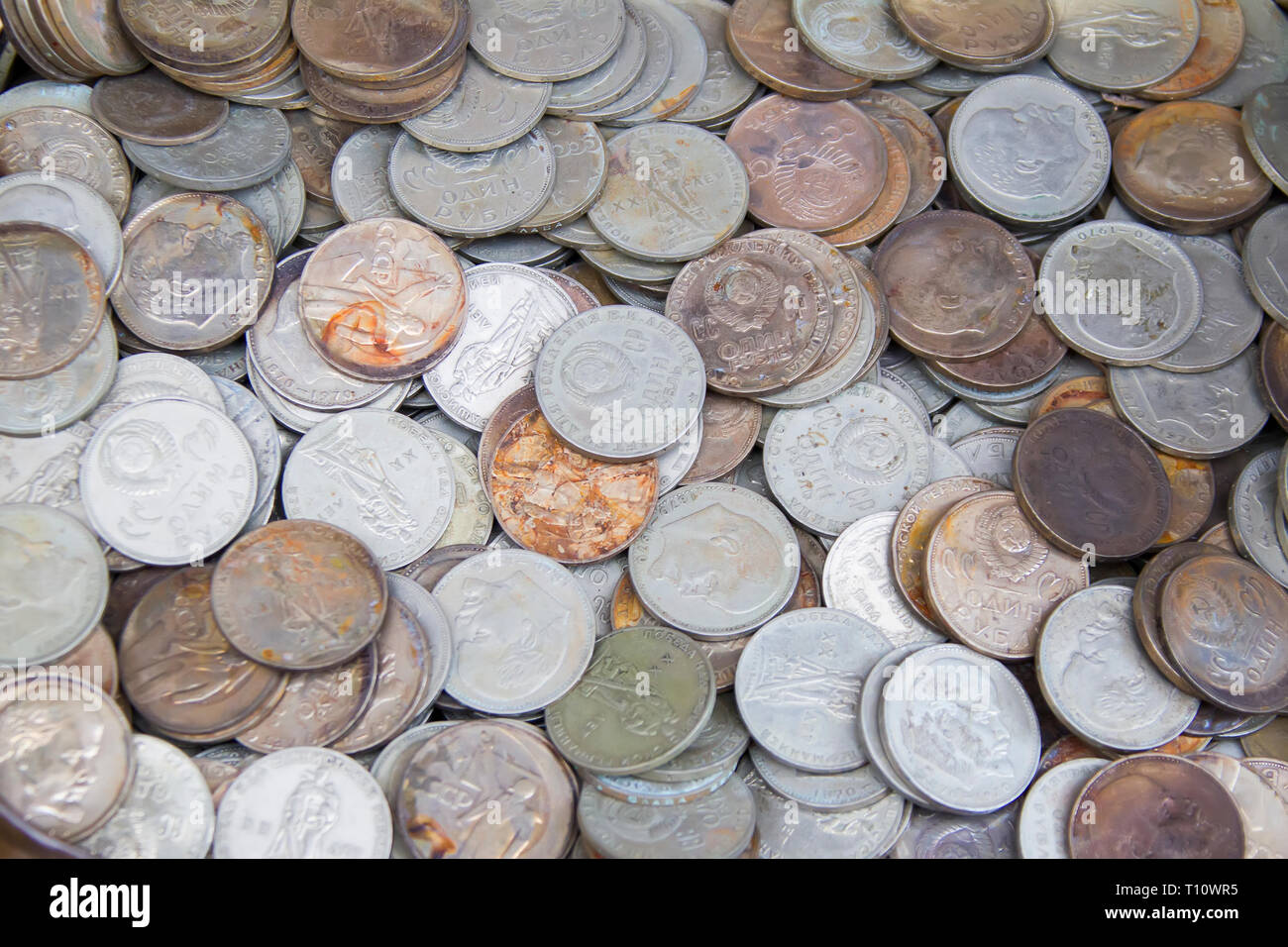 Soviet coins sprinkled on the whole frame of the photo. The USSR ruble. Old coins for numismatics Stock Photo