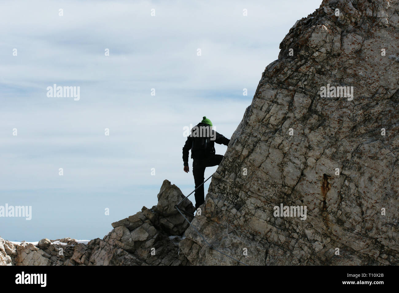 climbing in the alps - Stock Image