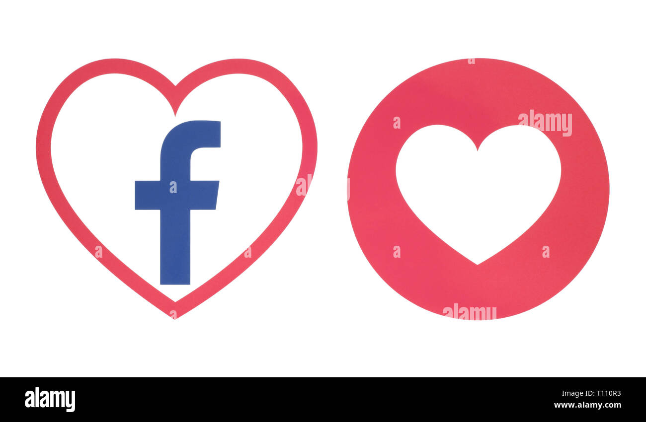 Kiev, Ukraine - November 28, 2018: Facebook heart icon with Love Empathetic Emoji Reaction printed on paper. Illustration of new Facebook feature - Stock Image