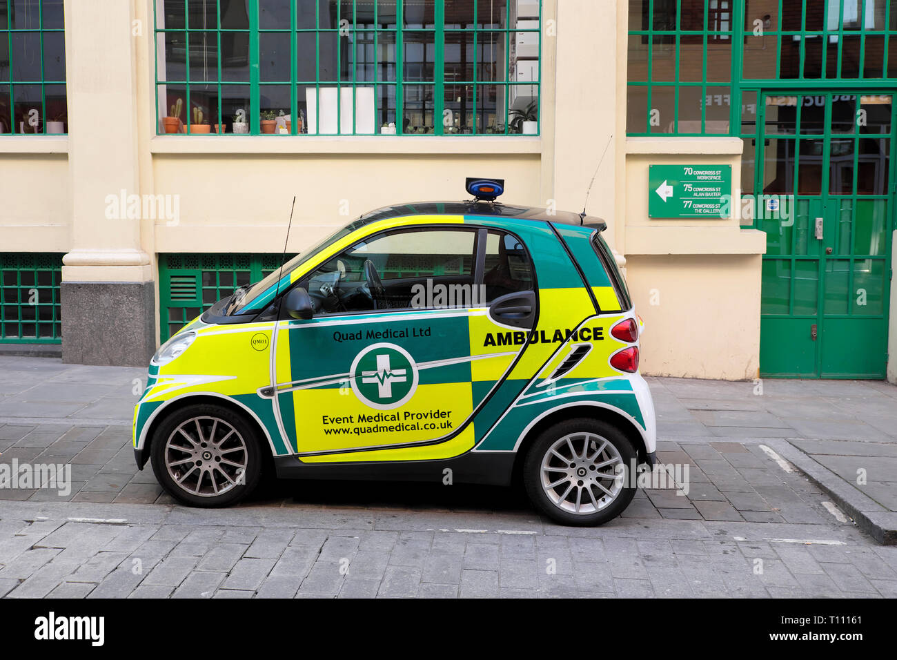 Quad Medical Smart Car event ambulance profile view parked outside a building in East London UK  KATHY DEWITT - Stock Image