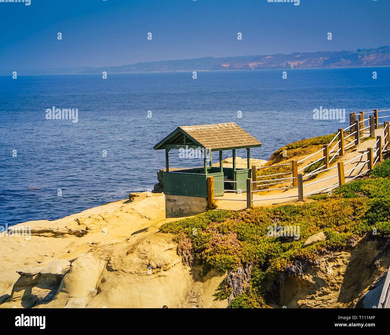 A view off the cliffs of La Jolla Cove and the Pacific Coast Highway near San Diego California Stock Photo
