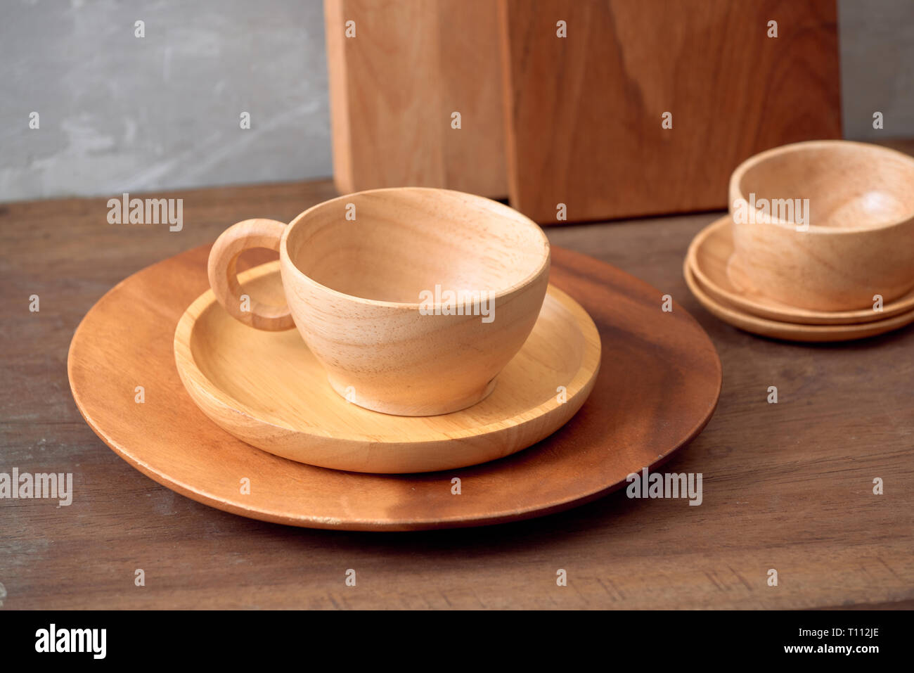 Kitchen tools for cooking on a wooden table on the background of a concrete wall. Copy space Stock Photo