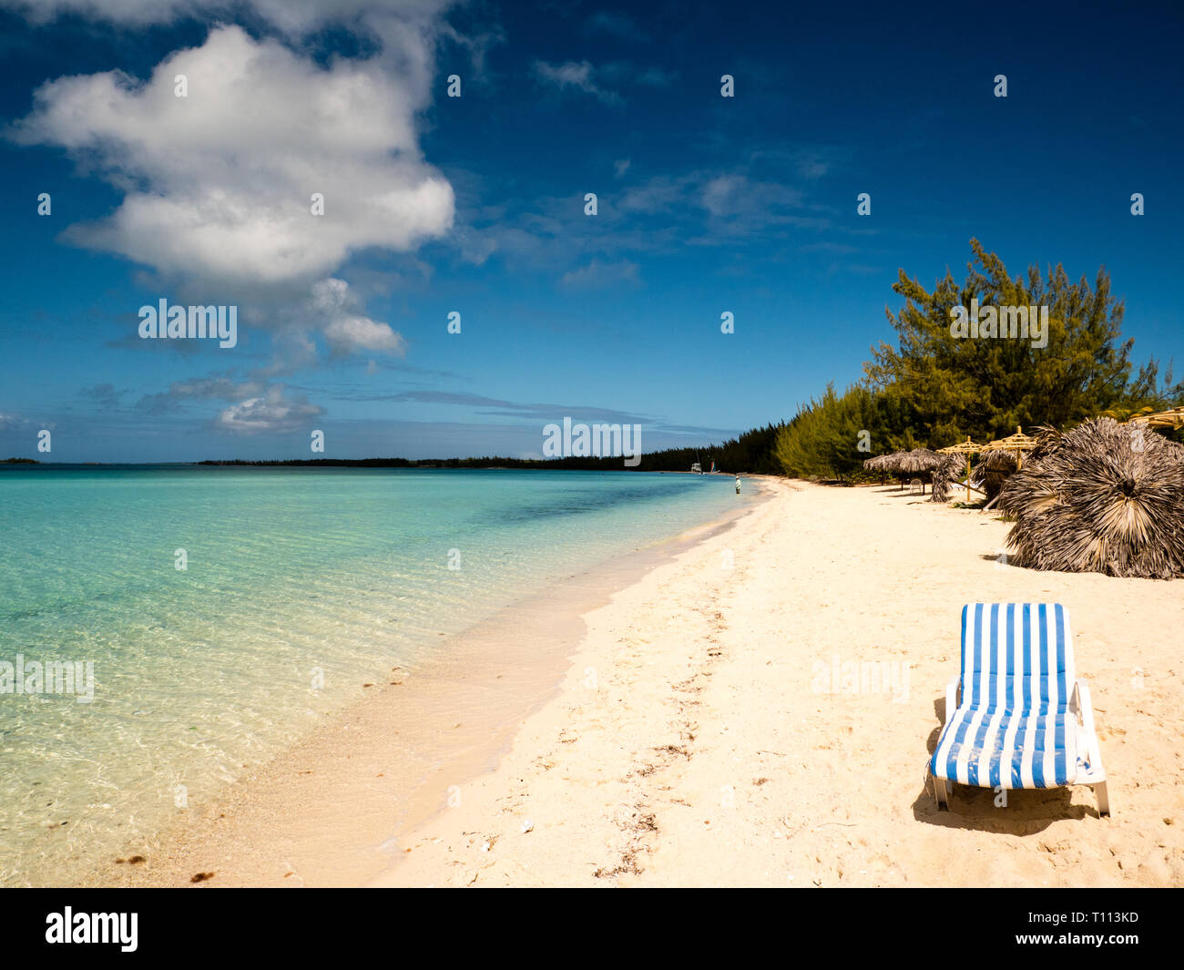 Blue and White Striped Sun Lounger, on Tropical Beach, Governors Harbour, Eleuthera, The Bahamas, The Caribbean. - Stock Image