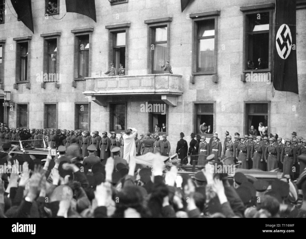 Nazism / National Socialism, politics, Annexation of Austria, 1938, Reich Chancellor Adolf Hitler on the balcony of the Chancellery after his return from Vienna, Berlin, March 1938, Anschluss, Herrmann Göring, crowd, crowds, crowds of people, Wilhelmstrasse, Greater German Realm, Greater Germany, Grossdeutsches Reich, Germany, German Reich, Third Reich, 20th century, 1930s, politics, policy, connection, connexion, connections, connexions, Chancellor of the Reich, Reichskanzler, balcony, balconies, historic, historical, Additional-Rights-Clearance-Info-Not-Available - Stock Image
