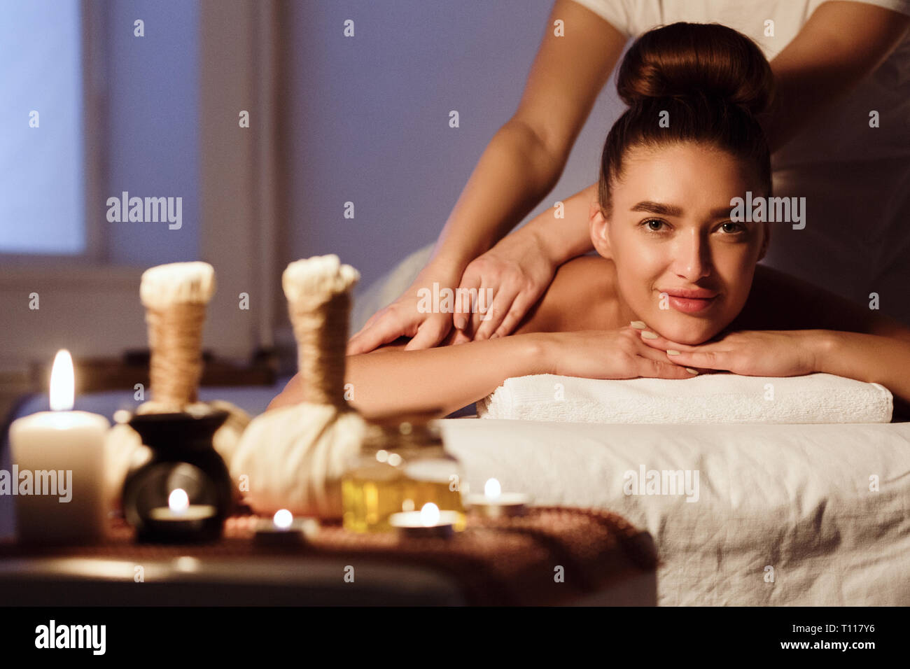 Traditional oriental aroma therapy. Woman relaxing in spa salon - Stock Image