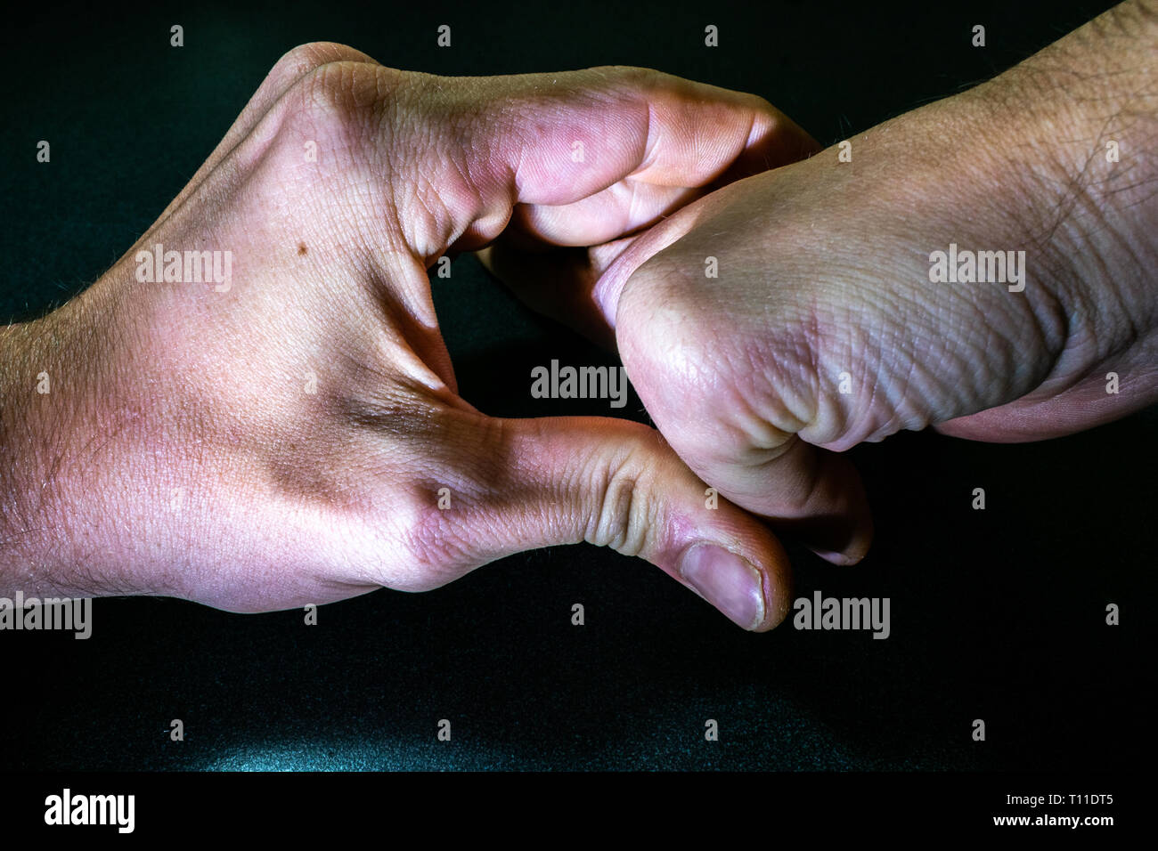 Cracking Knuckles - Stock Image