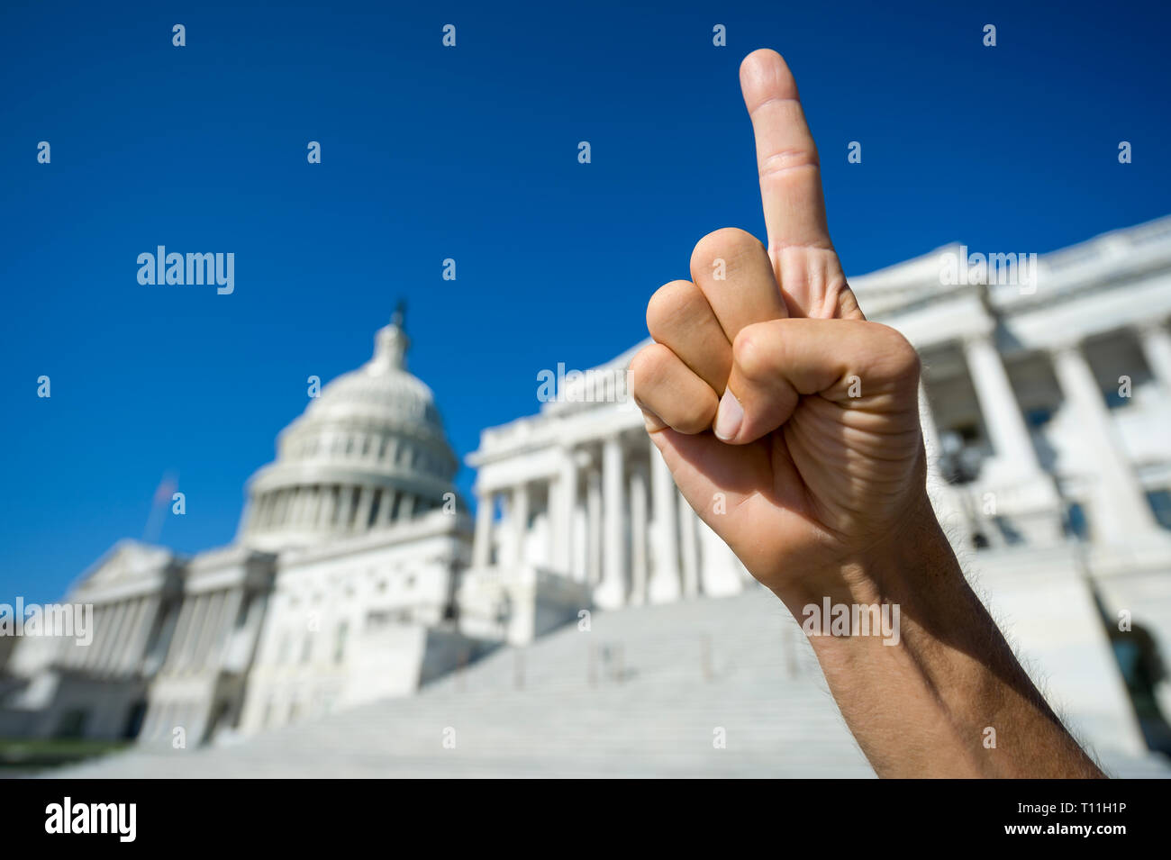 Hand of a proud America First protestor gesturing with a single index finger pointing skyward in front of the Capitol Building in Washington, DC, USA - Stock Image