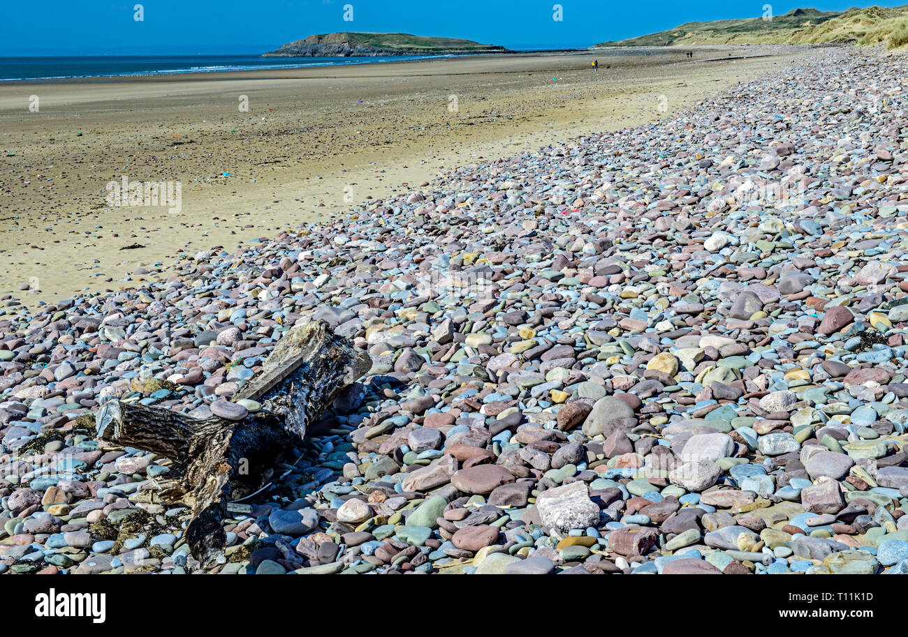 Rhossili Beach and Burry Holm on the Gower Coast, South Wales. All the Gower peninsula is an Area of Outstanding Natural Beauty, the first in the UK - Stock Image