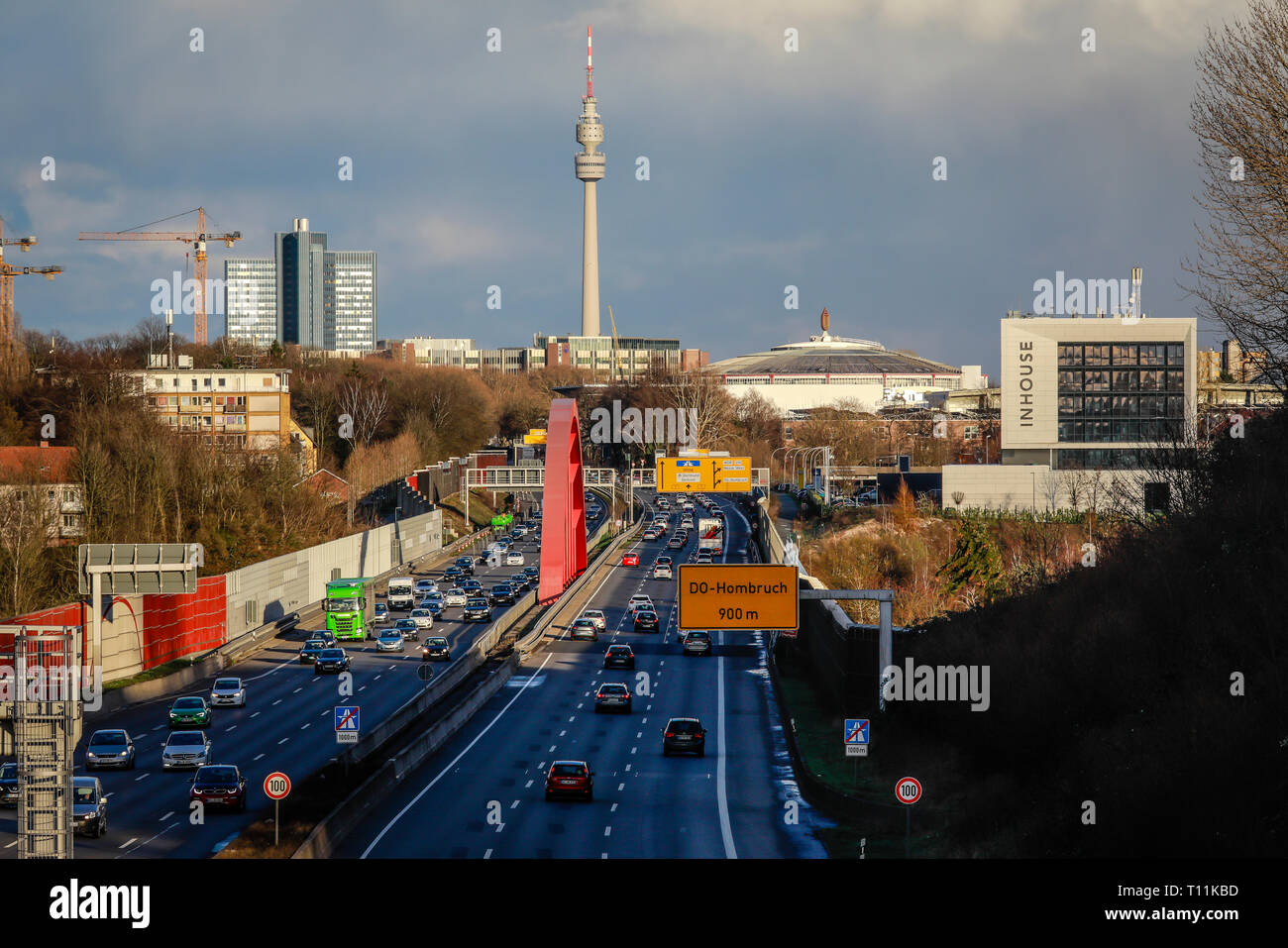 Dortmund, Ruhr area, North Rhine-Westphalia, Germany - City view with motorway A40, Westfalenhalle and radio tower. Dortmund, Ruhrgebiet, Nordrhein-We - Stock Image