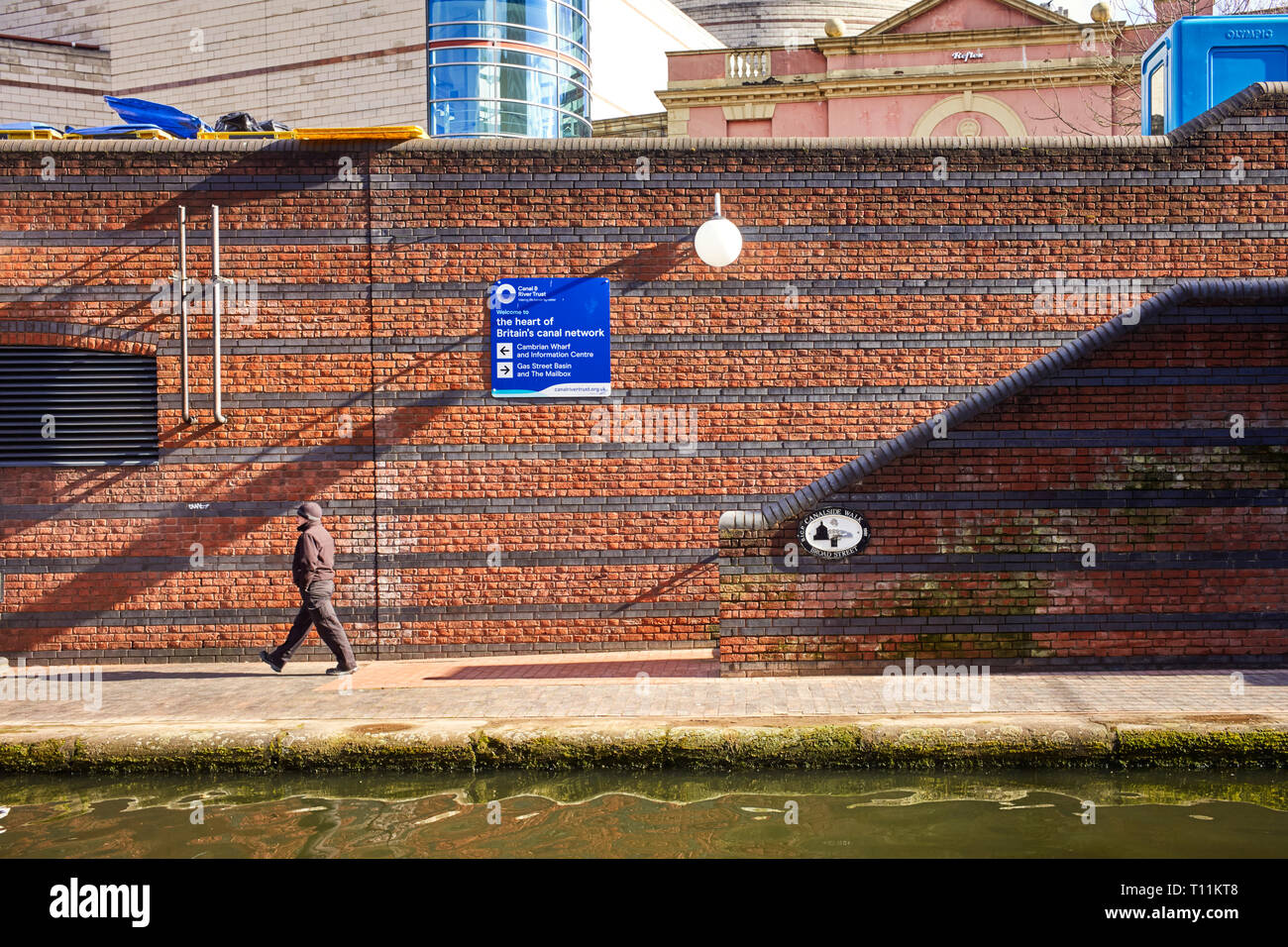 Canalside walk at Broad Street on the BCN canal network in the heart of Birmingham - Stock Image