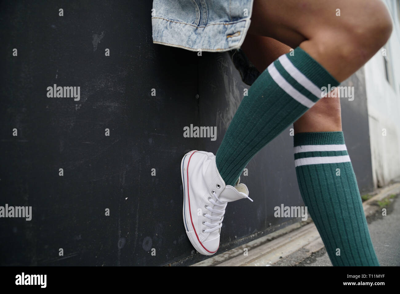 dd2c342dc Close up of woman s legs wearing knee socks in urban setting - Stock Image