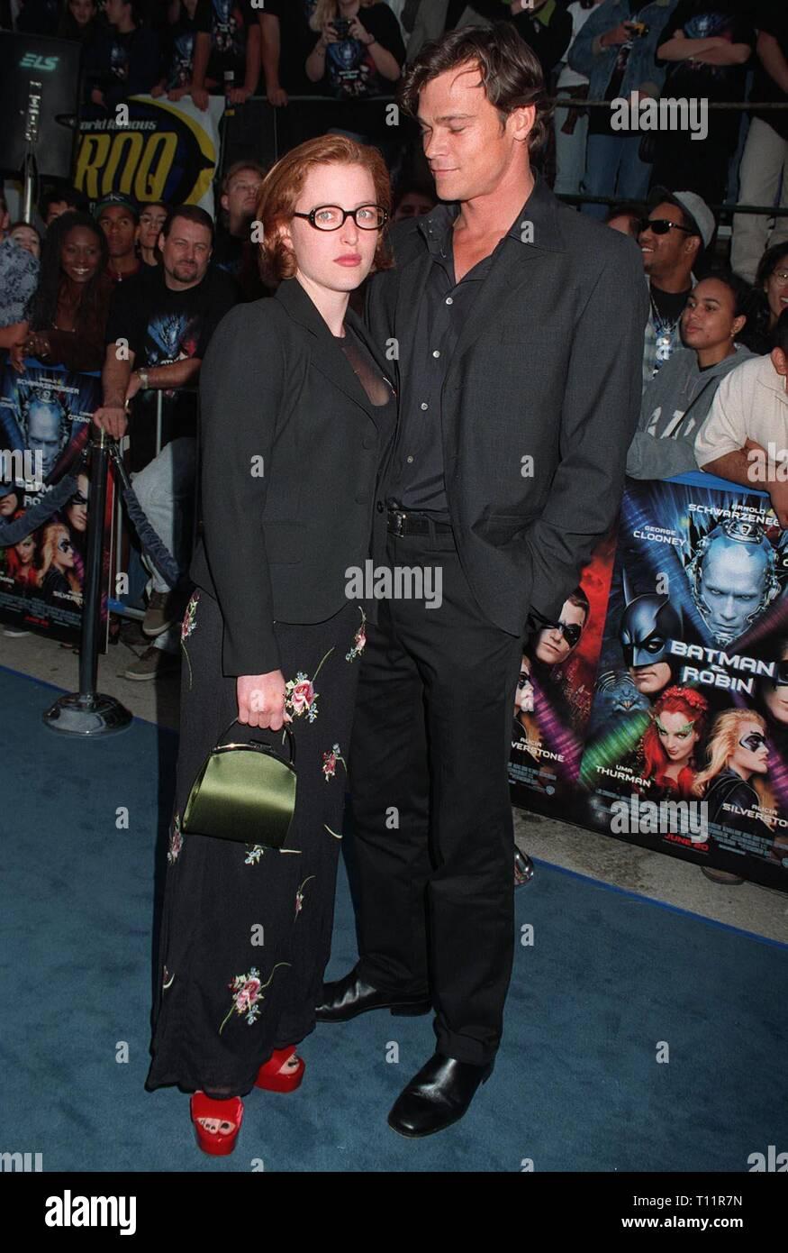 LOS ANGELES, CA. June 12, 1997: 'X-Files' star Gillian Anderson & boyfriend Rod Rowland at the World Premiere of 'Batman & Robin' in Los Angeles. - Stock Image