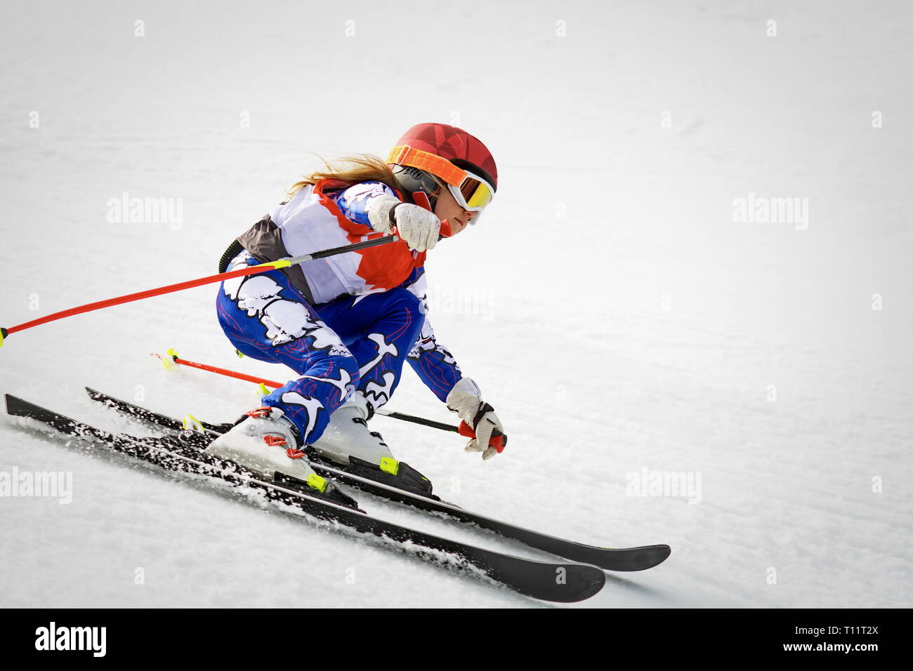 young skier in action in slalom ski competition downhill - Stock Image