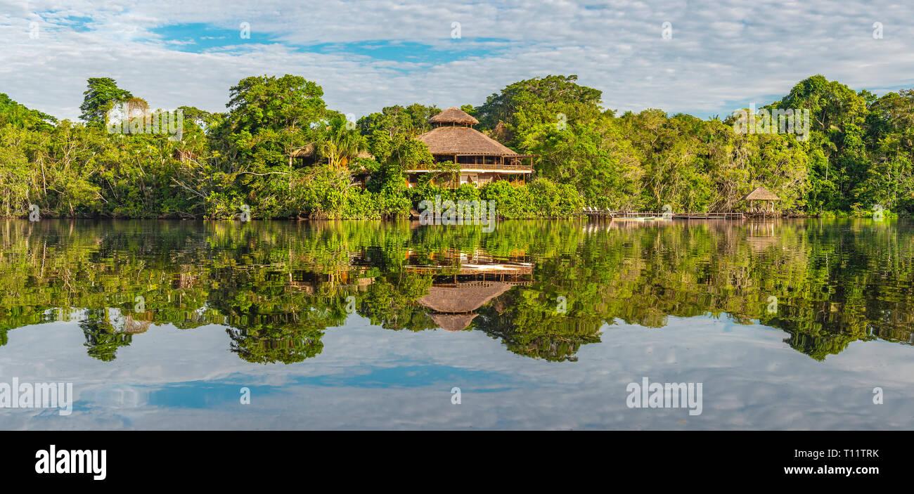 Rainforest Lodge Reflection.Tributaries of the Amazon river in Suriname, Guyana, French Guyana, Venezuela, Colombia, Ecuador, Peru, Bolivia and Brazil. - Stock Image