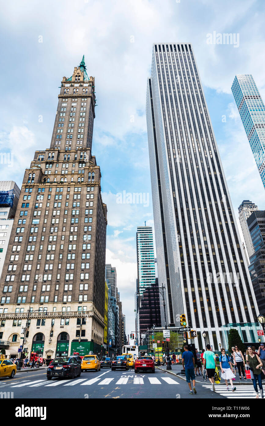 New York City, USA - July 28, 2018: Facade of The Sherry-Netherland and General Motors Building in Fifth Avenue (5th Avenue) with traffic and people a - Stock Image