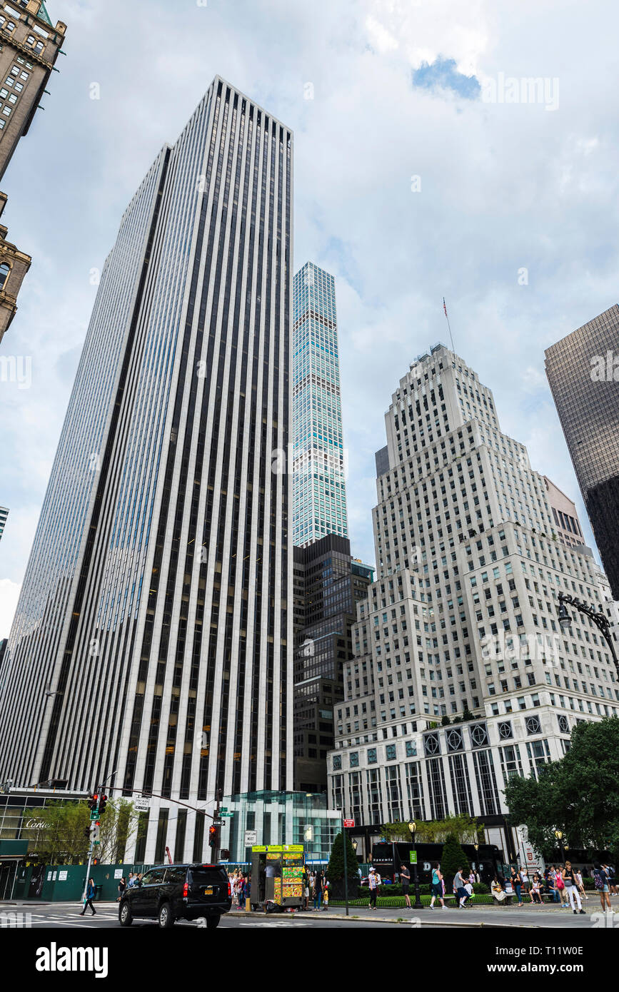 New York City, USA - July 28, 2018: Facade of the General Motors Building and other skyscrapers in Fifth Avenue (5th Avenue) next to Grand Army Plaza  - Stock Image