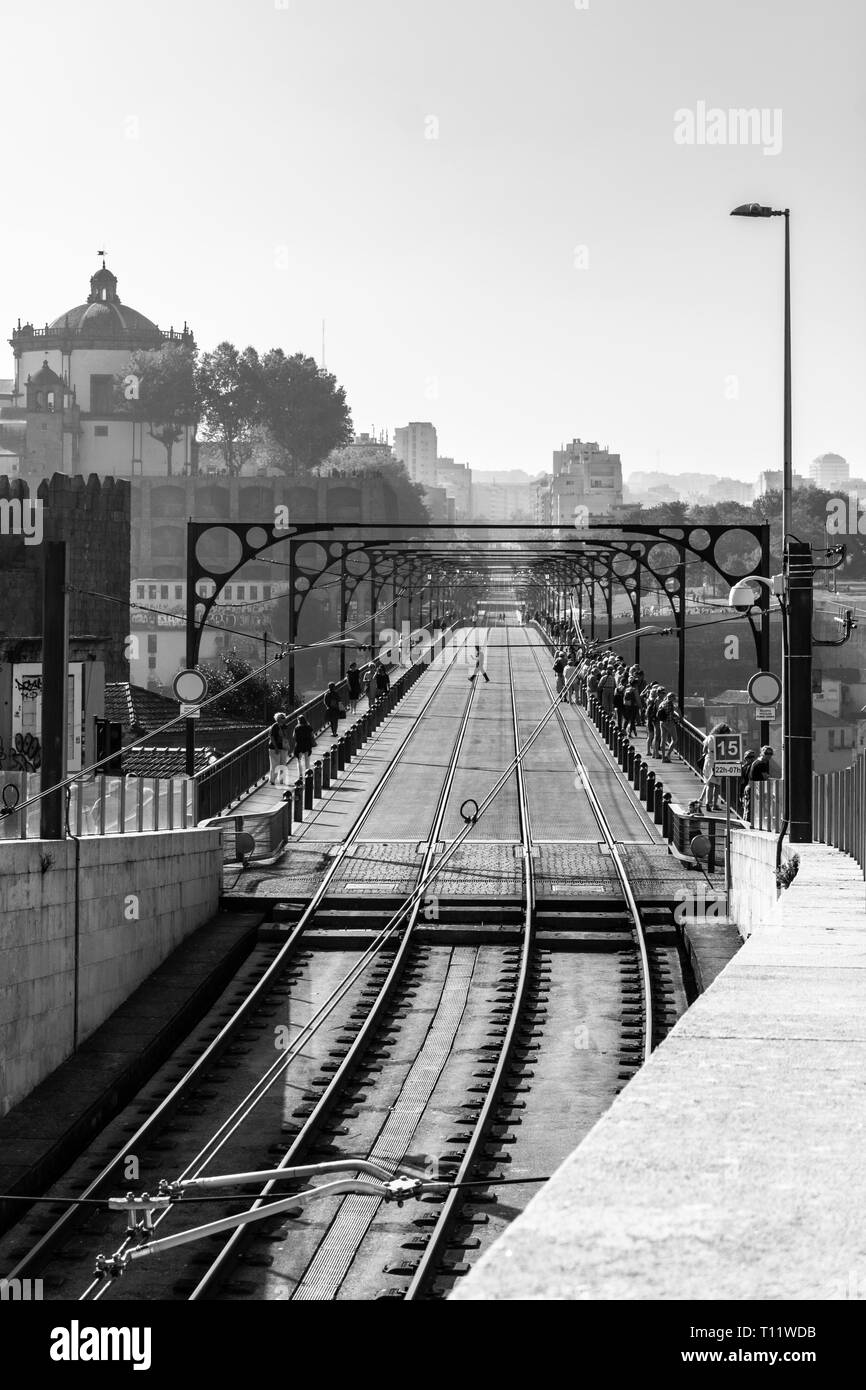 Dom Luis I Bridge view with subway train track in Porto Portugal. Panoramic view B&W photography - Stock Image