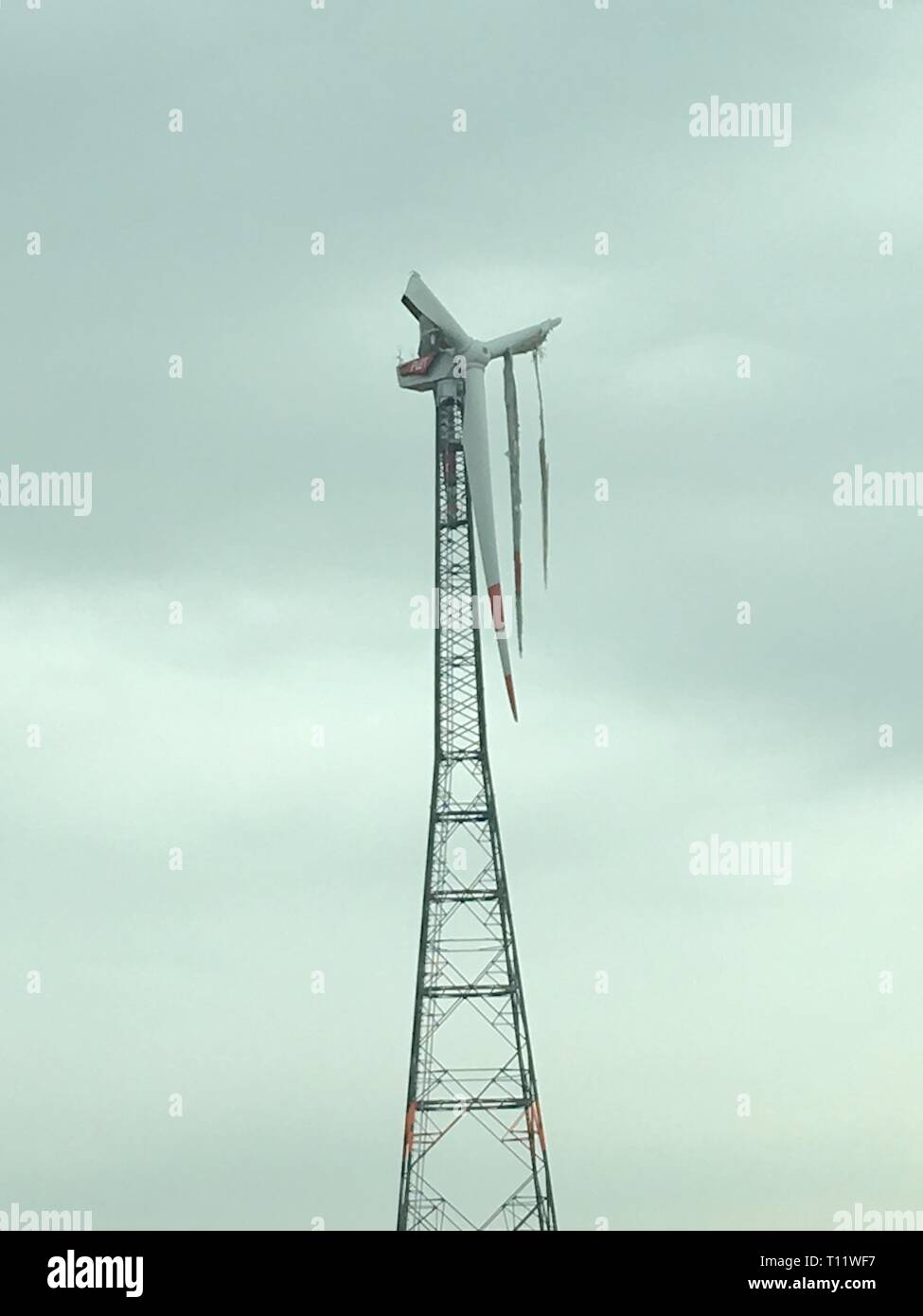 a broken windmill with broken wings - Stock Image