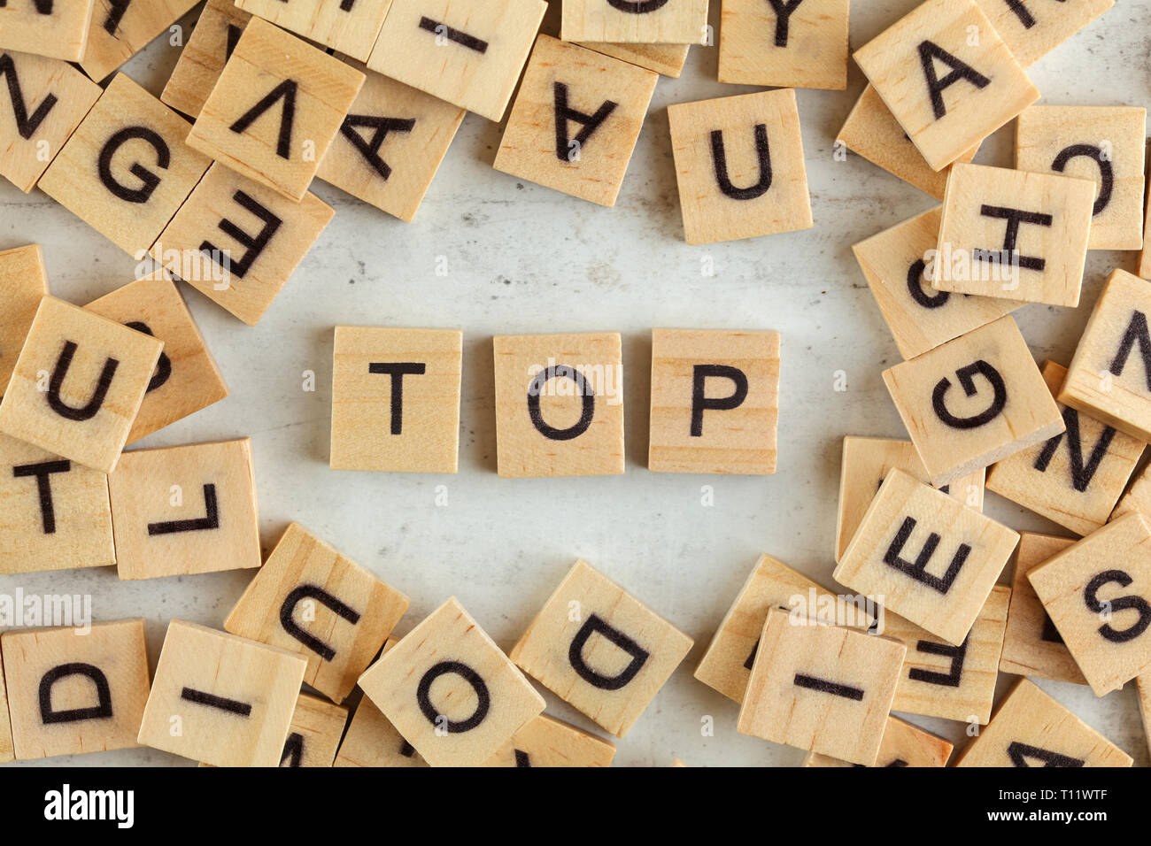 Top down view, pile of square wooden blocks with word TOP on