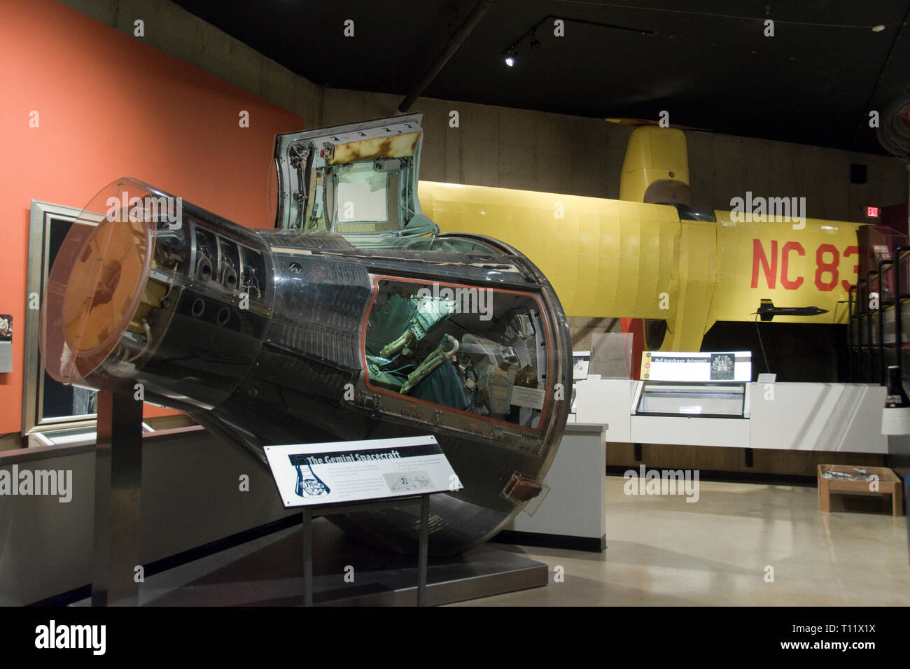 The Gemini 8 spacecraft flown by Apollo astronaut Neil Armstrong, and the Aeronca Champion airplane in which he learned to fly, in the Armstrong Air a - Stock Image