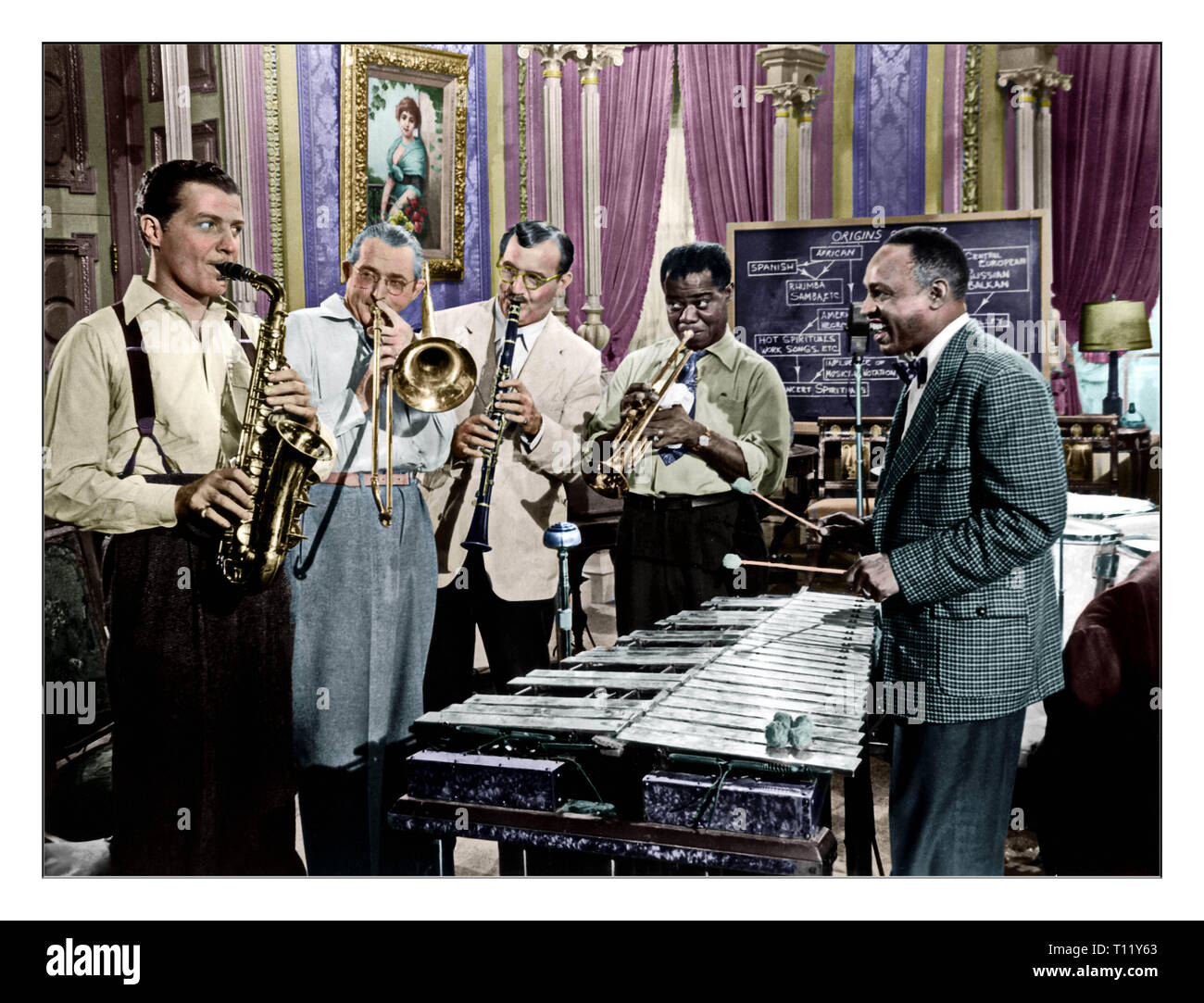 Armstrong was born and raised in New Orleans. Coming to prominence in the 1920s as an 'inventive' trumpet and cornet player, Armstrong was a foundational influence in jazz, shifting the focus of the music from collective improvisation to solo performance.[5] Around 1922, he followed his mentor, Joe 'King' Oliver, to Chicago to play in the Creole Jazz Band. In the Windy City, he networked with other popular jazz musicians, reconnecting with his friend, Bix Beiderbecke, and made new contacts, which included Hoagy Carmichael and Lil Hardin. He earned a reputation at 'cutting contests', and reloca - Stock Image