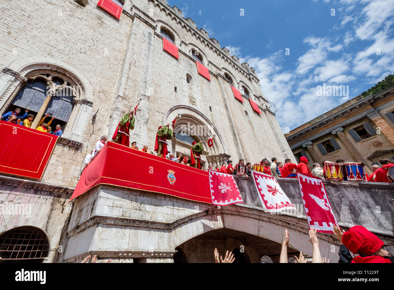 434bc46b GUBBIO, ITALY - MAY 15 2016 - The trumpeters fanfare welcomes the Ceri into  the