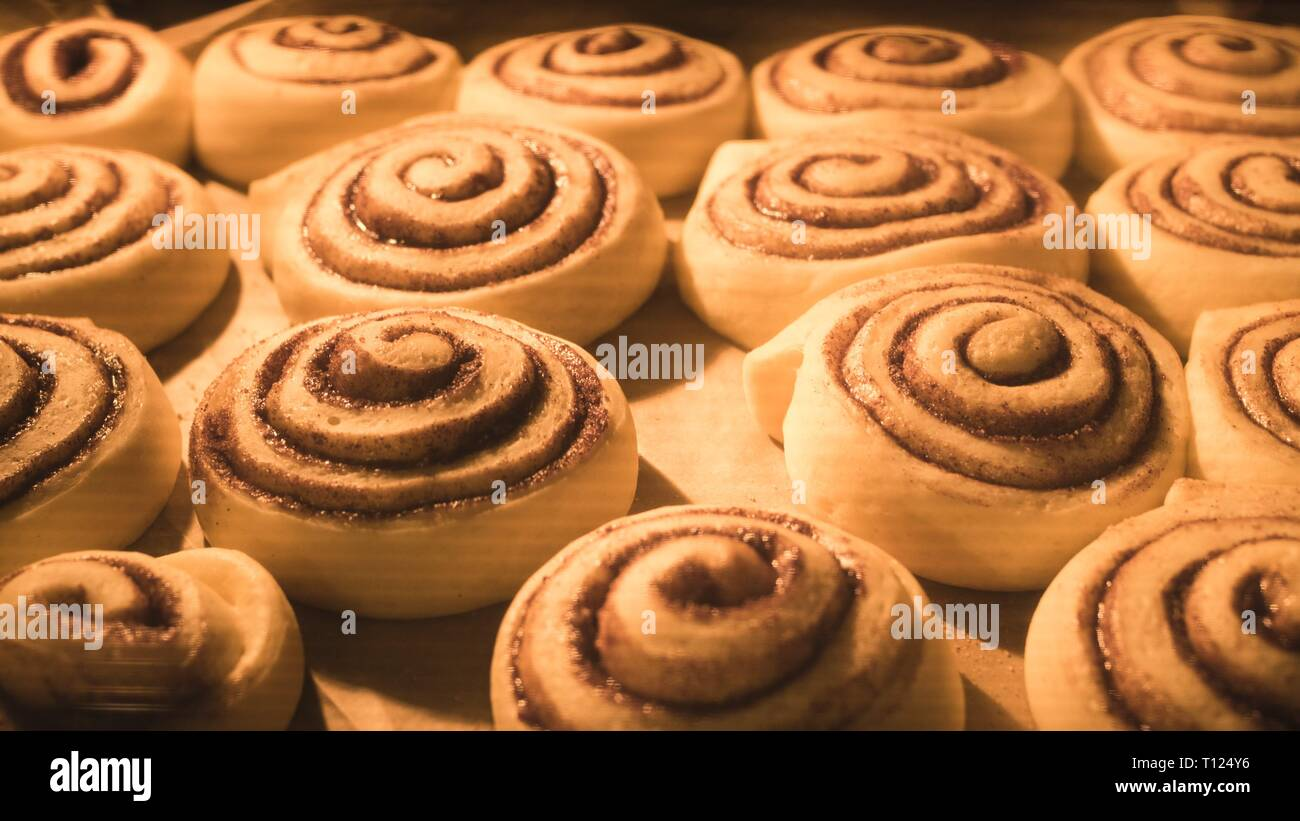 Time-lapse video of croissants baking in oven - Stock Image