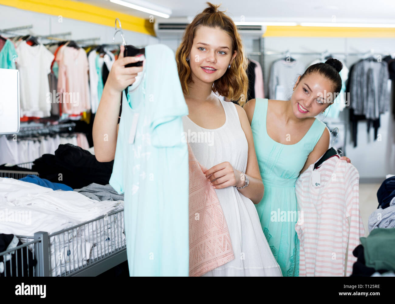 90ede11061059 Funny young women shopping at the clothing store Stock Photo ...