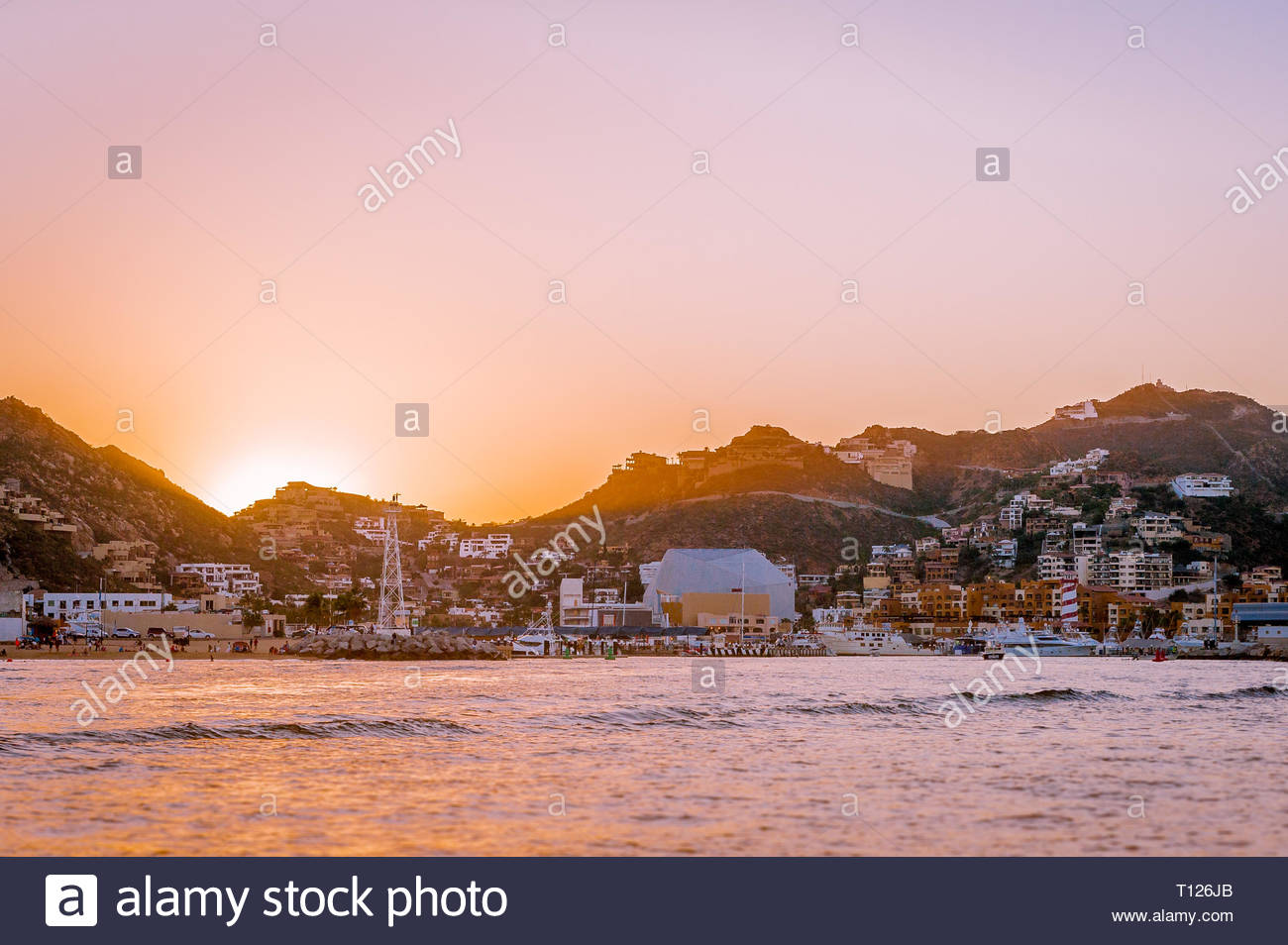 Sunset over Cabo San Lucas as seen from the water - Stock Image