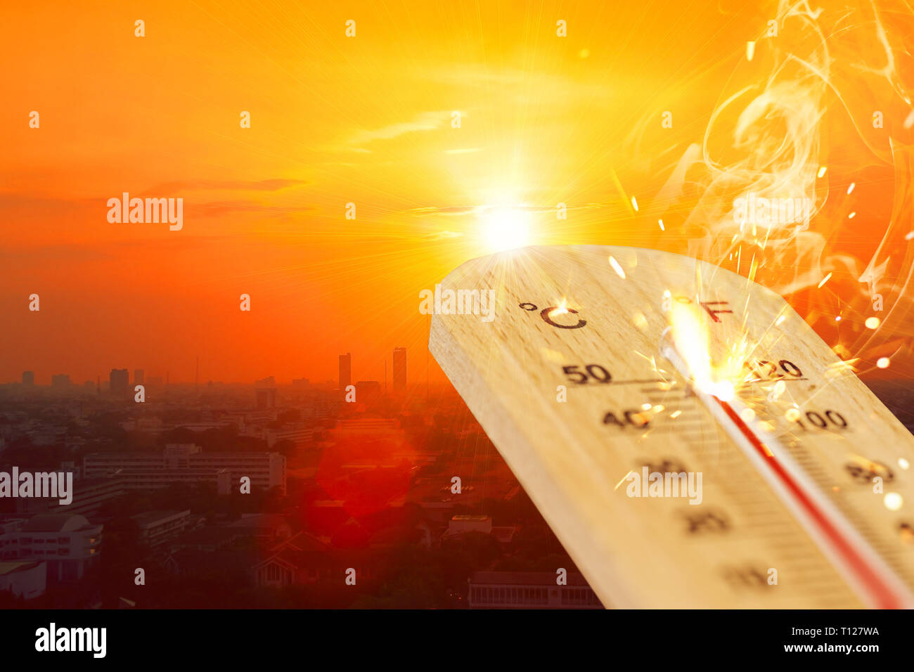 summer hot weather season high temperature thermometer with city view. - Stock Image
