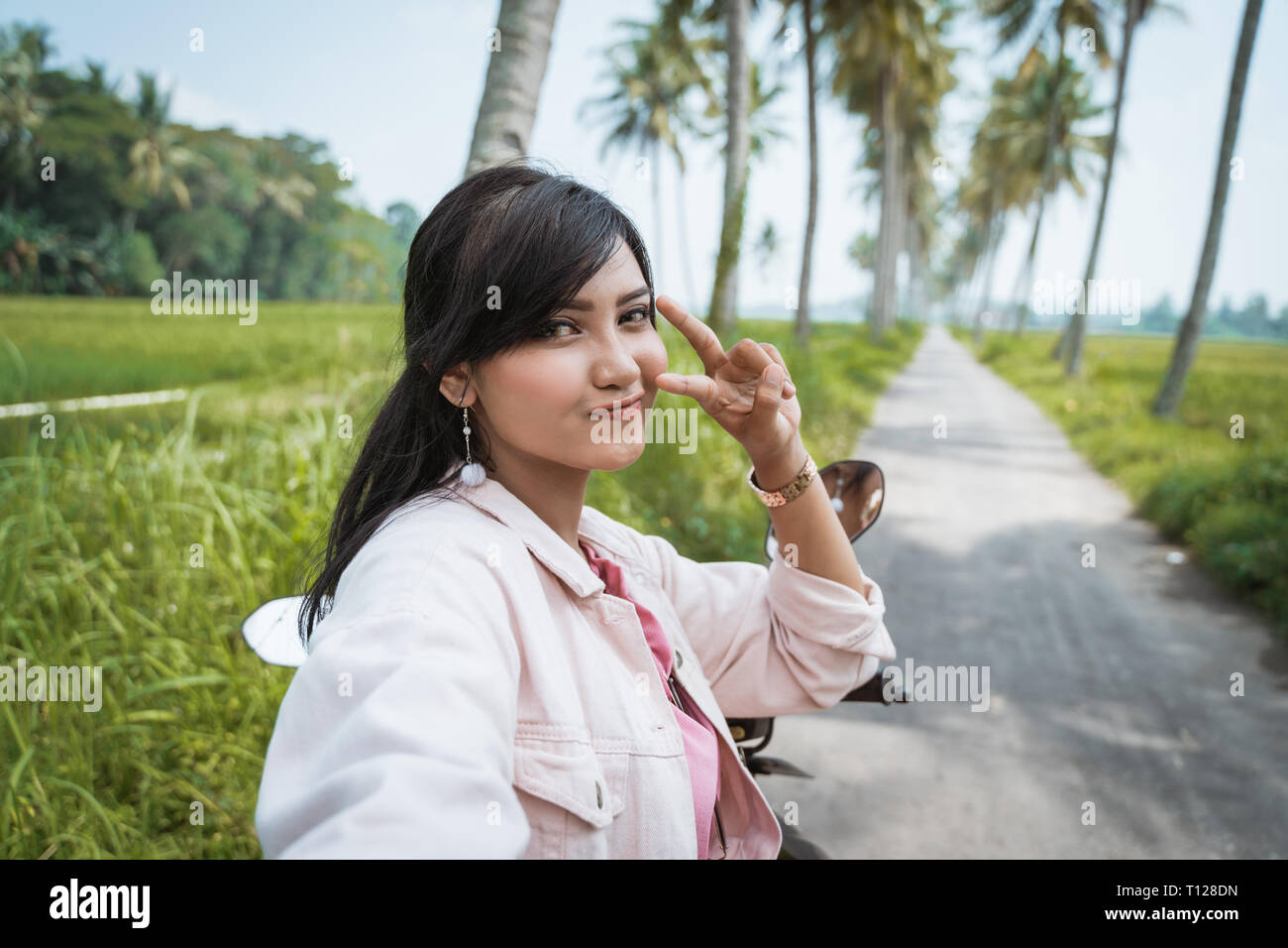 5465f2a9c selfie asian woman posing to camera outdoor - Stock Image