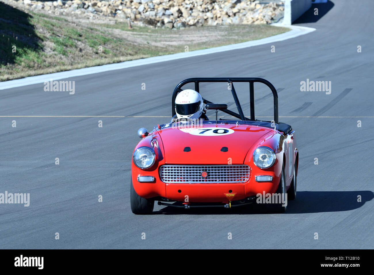 Red Racing Car MG At Marulan Race Track In NSW Australia. Only Car On Track Going Down The Straight. - Stock Image