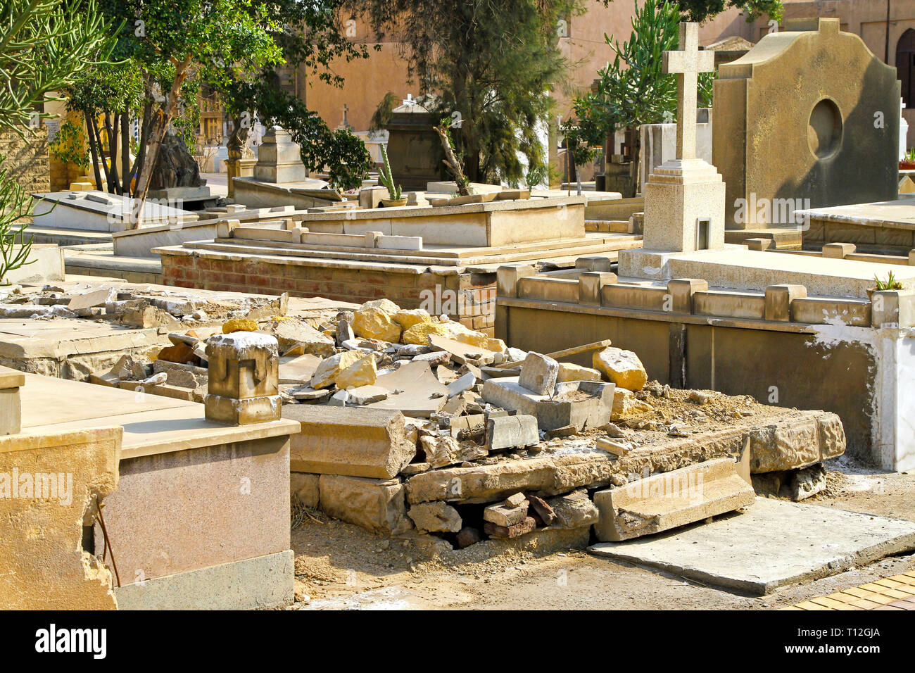 Destroyed and ruined grave at Christian cemetery - Stock Image
