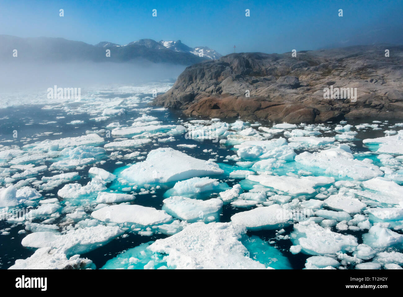 Floating ice on the ocean and island in Prins Christian Sund, Greenland - Stock Image