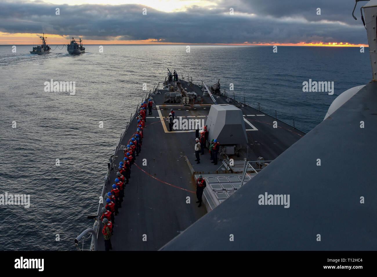 190321-N-JX484-242 ENGLISH CHANNEL (Mar  21, 2019) Sailors man the