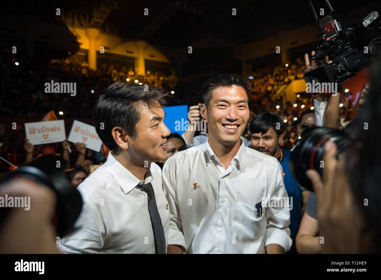 Secretary general of Future Forward Party Piyabutr Saengkanokkul and Future Forward Party Leader Thanathorn Juangroongruangkit seen during the Future Forward Party latest rally before the Thai General Election at the Thai-Japanese Stadium in Bangkok. The country will hold the general election on March 24, 2019, five years after the May 2014 military coup Stock Photo