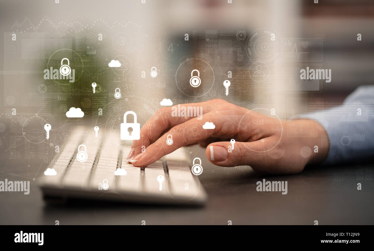 Business woman hand typing on keyboard with secured lock concept around  - Stock Image