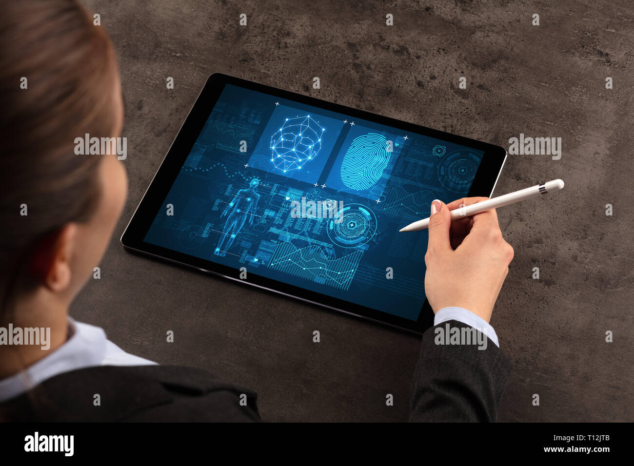 Business woman making analyses and checking fingerprints on tablet  Stock Photo