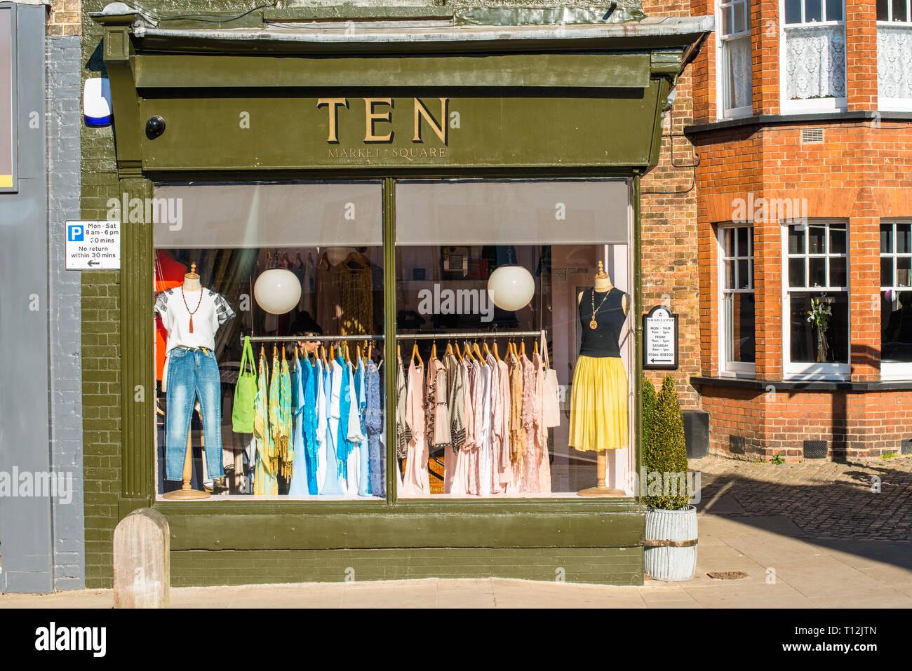 Quaint little dress shop on Market place, Downham Market, Norfolk, East Anglia, England, UK. - Stock Image