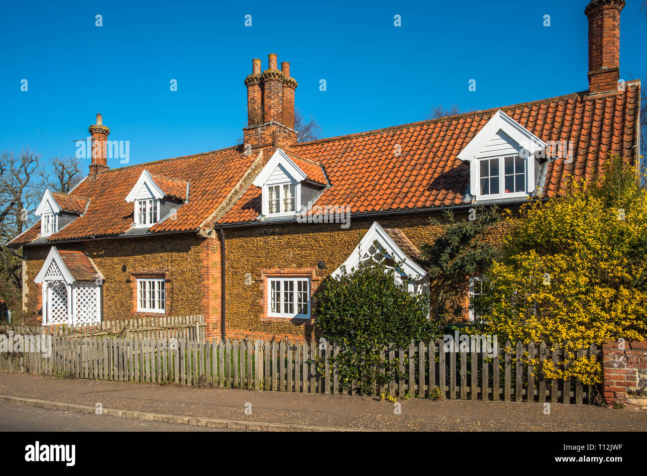Characterful cottages in the village of Castle Rising in Norfolk, East Anglia, England, UK. - Stock Image