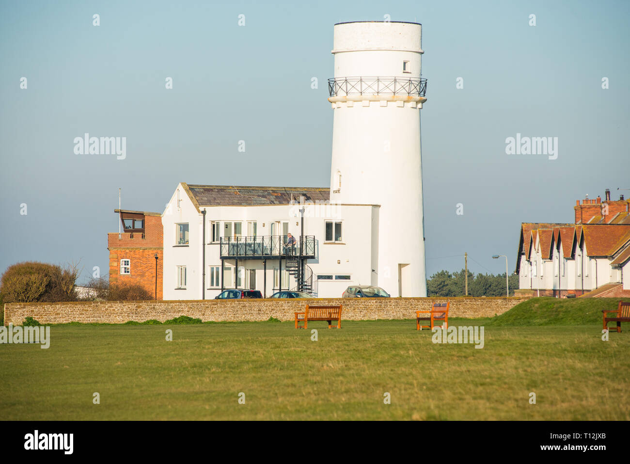 The old lighthouse at the top of the cliffs in Hunstanton, now used for holiday lets. Norfolk coast, England, UK. - Stock Image