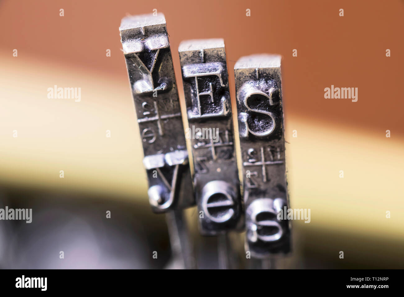 Macrophotography of typewriter hammers with YES word Stock Photo