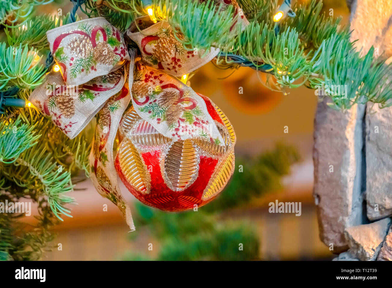 Bauble And Bow On A Christmas Tree With Lights Close Up Of An
