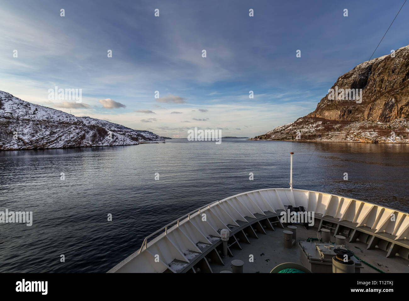 Cruising through the Norwegian Fjords during the winter months. - Stock Image